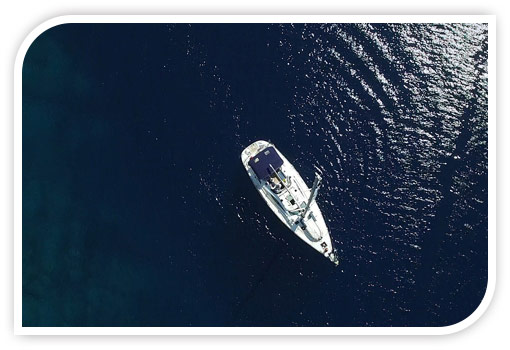Yacht white boat on blue sunlight ocean sea water
